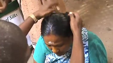 Indian lady long hair shaved with her bun