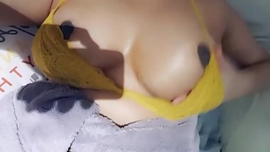 Indian Girl Rubbing Oil on her Tits