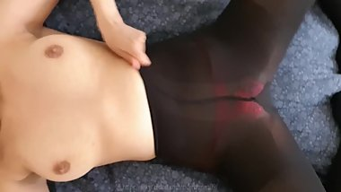 Whore in black pantyhose and see through panties masturbating