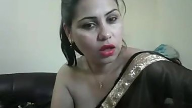 hot desi girl on cam showing boobs and teasing in a saree with hindi audio.