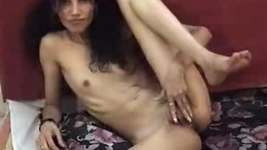This horny Indian slut strips and rubs on her cunt